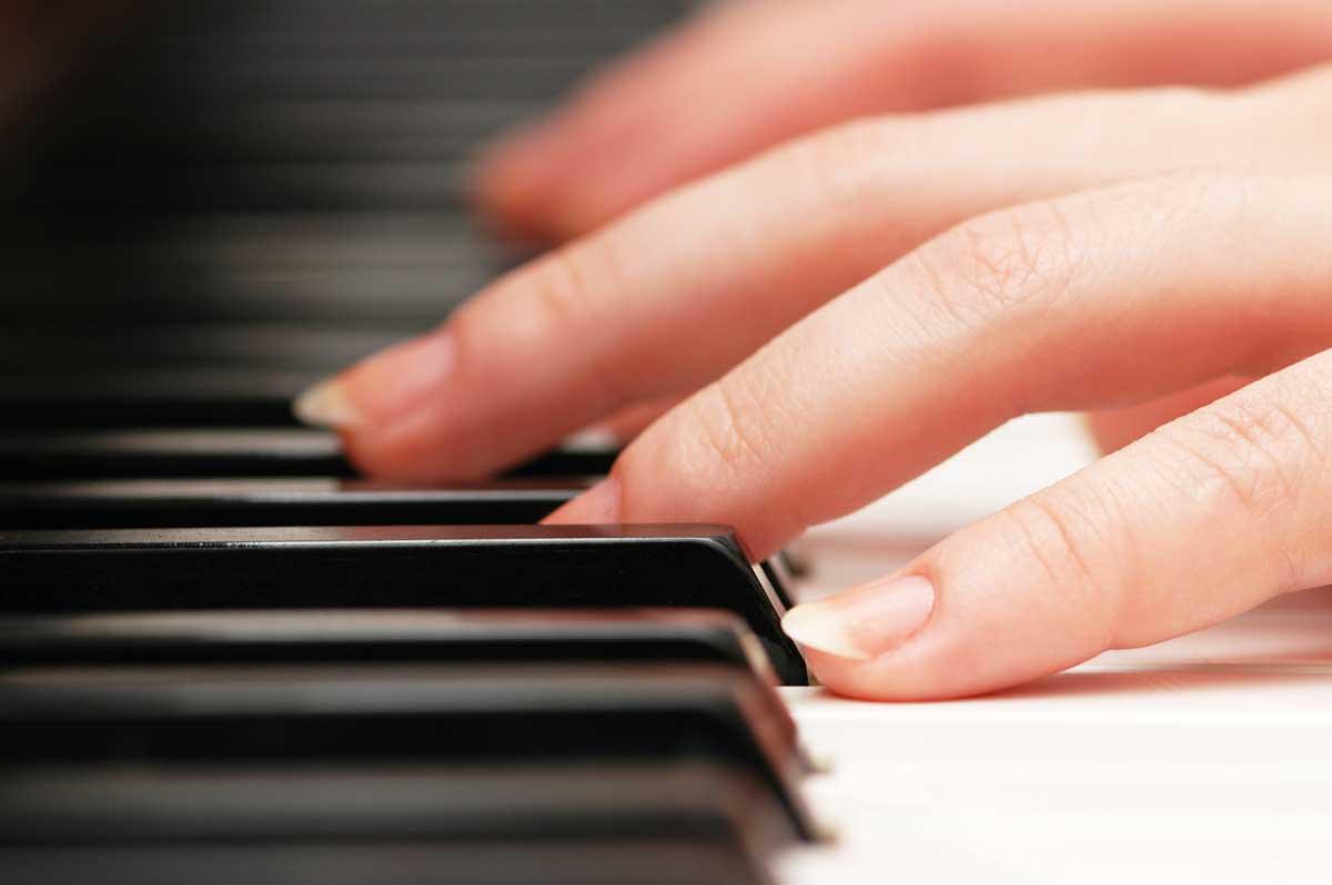 closeup-of-hands-playing-piano